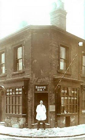 George Albert Winfield outside his barbers shop
