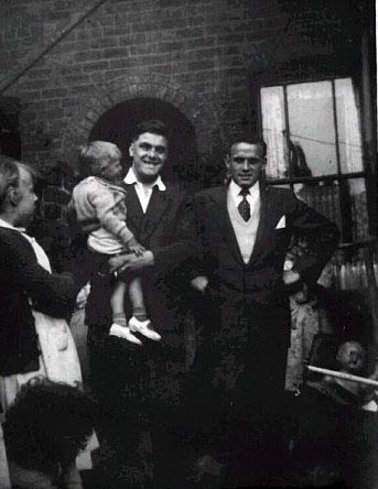 Diane Morris, John Colin being held by Ronnie Colin, Roly Morris, 25, Clarendon Street, circa 1958